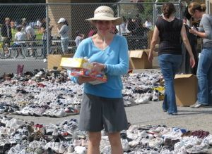 Teresa with shoes collected for Zimbabwe